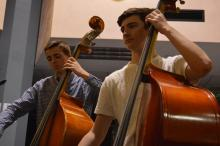 Bassists Philipp Roehm and Zach Benko keep the beat steady for their ensemble.