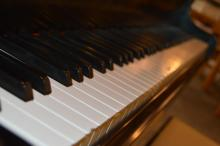 Photo of piano keyboard.