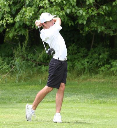 Josh Yoder fires a shot off the tee.
