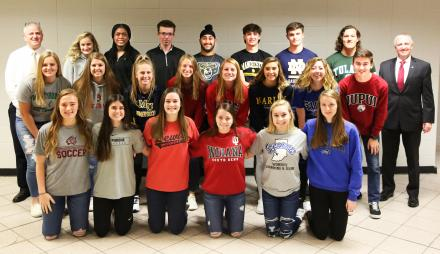 P-H-M Supt. Dr. Jerry Thacker, Penn High School Athletic Director Jeff Hart, and the 21 Kingsmen student-athletes who signed National Letters of Intent.
