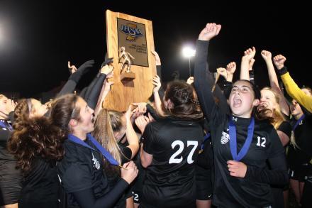 Penn Girls Soccer players celebrate winning the State Championship.