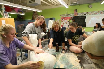 Sculpture students working on the Hulk Magic Wheelchair