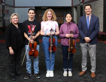 From left, Penn Orchestra Director Anne Tschetter, Joey Krachenfels, Maya Kvartskhelia, Erica Cheng and Penn High School Principal Sean Galiher. Krachenfels, Kvartskhelia and Cheng were named to the Indiana All-State Orchestra.