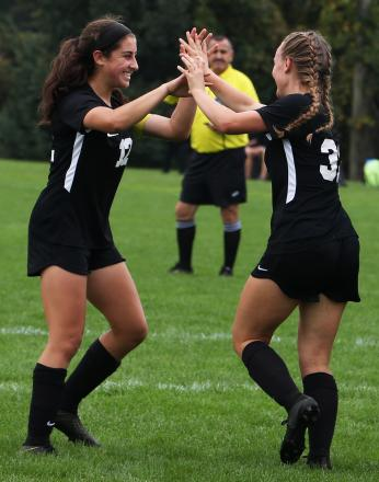 Maya Lacognato and Lauren Hamilton celebrate a Penn goal.