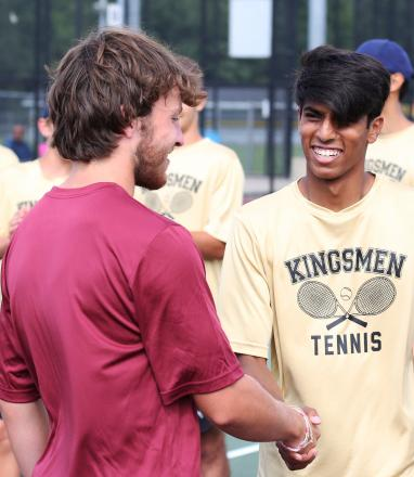 Sid Das shakes hands with his opponent from Mishawaka before a Penn Boys Tennis match.