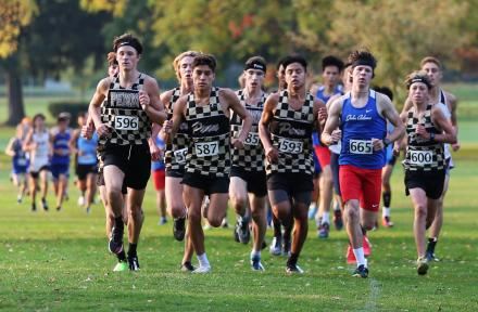 The Penn Boys Cross Country Team runs in a pack at the lead of the South Bend Sectional on Saturday, Oct. 10, 2020.