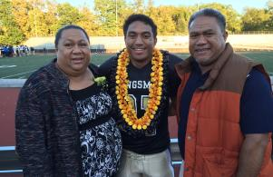 Cedric Vakalahi and parents at football senior night