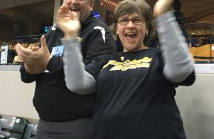 Penn High School principal Steve Hope and his wife, Penn art instructor Becky Hope, cheer on the Penn girls basketball team at the state championship game.