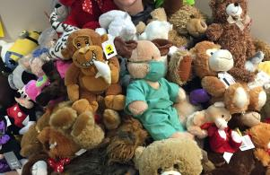 Penn High School student Riley Smith with teddy bears collected for a local children's hospital.