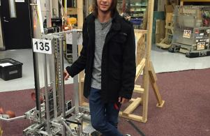 Penn High School Robotics student Dylan Hill working in the latest project.