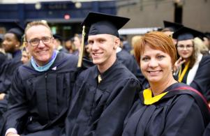 Penn grad Evan Poling is flanked by his parents Ken and Kim Poling, both teachers at Penn High School.