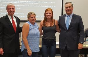 State long champ Mikaylah Woods, joined by mother Amanda Gibbons, is congratulated at the July 25 school board meeting.