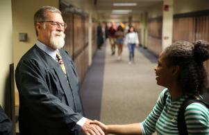 Early College Academy Teacher Jim Schmidt welcomes students back