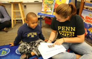 Freshmen from Penn High School's Early College Academy read stories they wrote for Meadow's Edge students (Oct. 11)