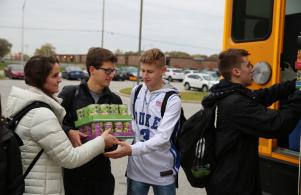 Penn FCA members load cans collected for Student Hunger Drive